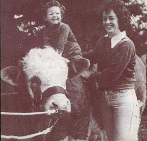 Happiness is the borad back of a Simmentl bull, for Prue Gray, with mum Jan Gray from 1978. From the booklet 40 years of Simmental in Australia released 2012