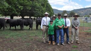"""Elite Livestock Auctions' Chris Norris and Glassers Total Sales Management's Michael Glasser flank vendors Austin, Tara, and David Brewer, with purchaser of top-price bull Stewart Macoun, """"Boongala"""", Peak Hill."""