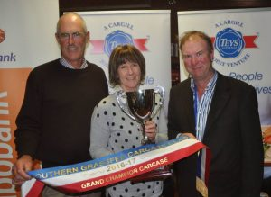 Chris and Maris Bateman, Furner are congratulated on winning the grand champion carcase award by SGCC chairman Allan Kain. Photo by Stock Journal