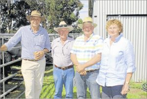 Catching up after the sale were Bonnydale stud co-principal Mike Introvigne (left), Bonnydale Eastern States representative Ian Collie with long time Bonnydale clients Rod and Kerry Newnham, Euroa, Victoria, who bought one Black Simmental and two SimAngus bulls during the sale.